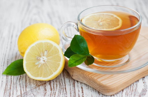 Tea cup  with lemon on a wooden table